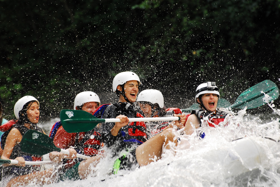 Celeste Von Ahnen gets hit by the water of the Ocoee River while whitewater rafting with friends.