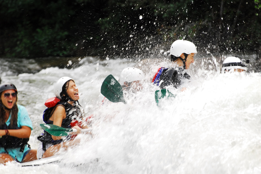 Alicia Doroteo prepares to get hit in the face while whitewater rafting the Ocoee River with friends.