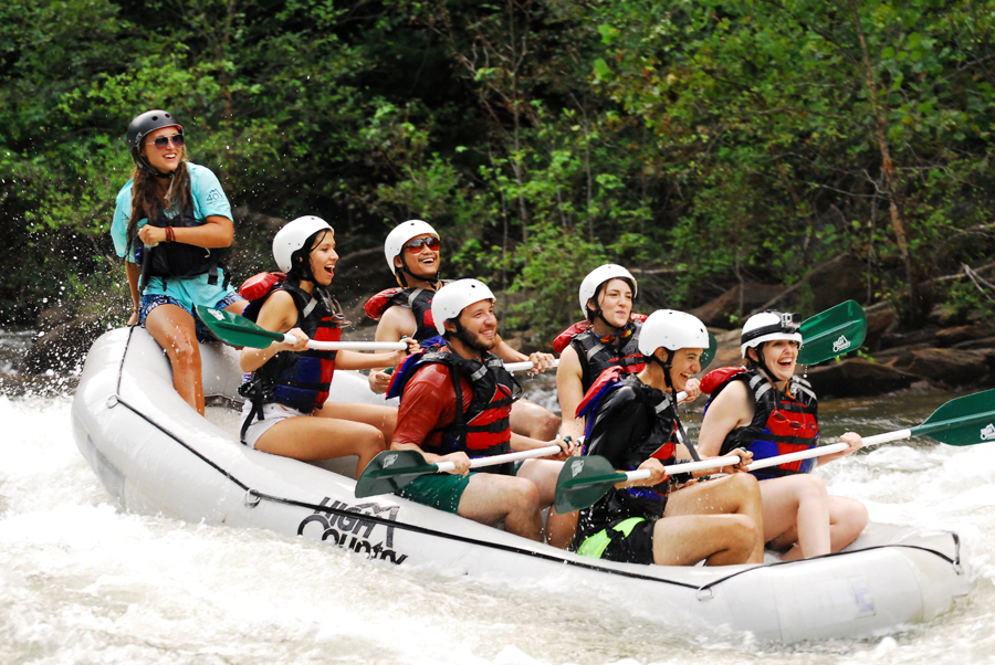 Kevin Banogon, Meredith Lambert Banogon, Alicia Doroteo, Michael Meredith, Zoe Gordon, and Celeste Von Ahnen laugh after going through a particularly exciting rapid down the Ocoee River.