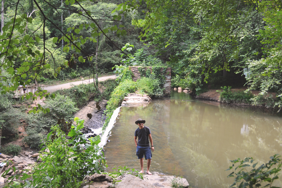 Kevin Banogon stands on the edge of Old Roswell Falls to see the view from the top.