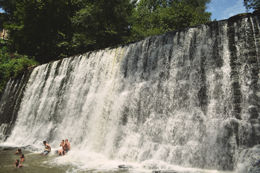 The public enjoys a refreshing dip in the waters of the Old Roswell Mill Falls on a hot Atlanta day.