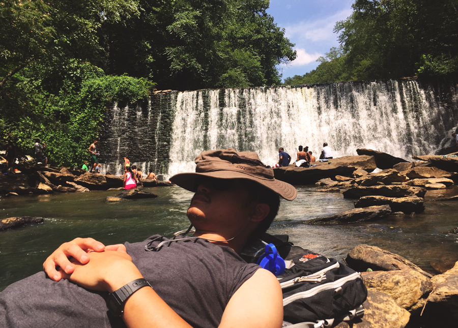 Kevin Banogon enjoys a lazy Sunday catching a nap by Old Roswell Mill Falls.