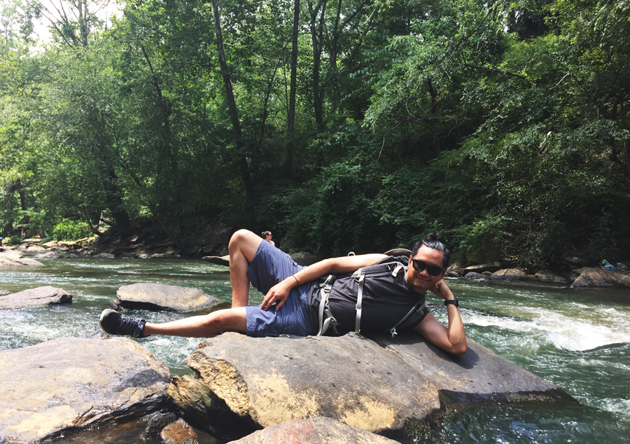 Kevin Banogon does the Don Bailey pose on the rocks of the Old Roswell Mill Falls in Atlanta, Georgia.