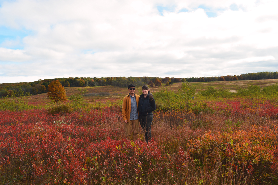 Kevin Banogon and Meredith Lambert Banogon stand among the fall colors of Big Meadows in Shenandoah National Park.