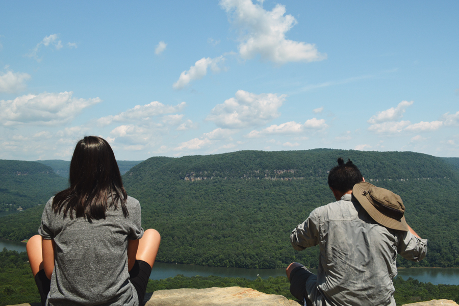 Alicia Doroteo and Kevin Banogon sit and enjoy the scenic view from Snooper's Rock in Chattanooga, Tennessee,