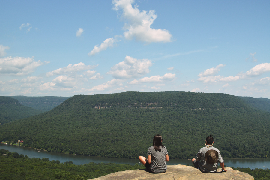 Kevin Banogon and Alicia Doroteo sit on the edge of Snooper's Rock as they view the Tennessee River.