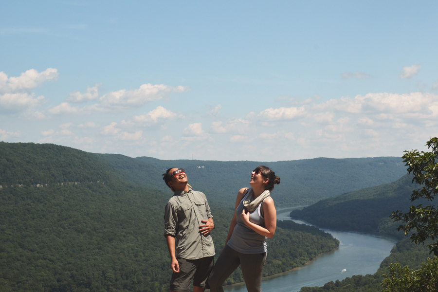 Meredith Lambert Banogon and Kevin Banogon laugh in the sky on Snooper's Rock in Chattanooga.