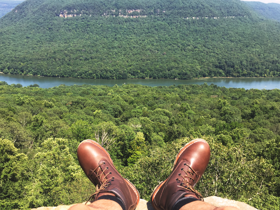 Kevin Banogon hangs his feet off the edge of Snooper's Rock facing the Tennessee River.
