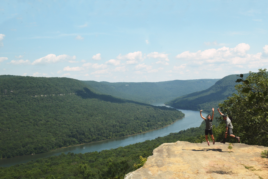 Alicia Doroteo and Kevin Banogon jump in the air on top of Snooper's Rock in Chattanooga, Tennessee.