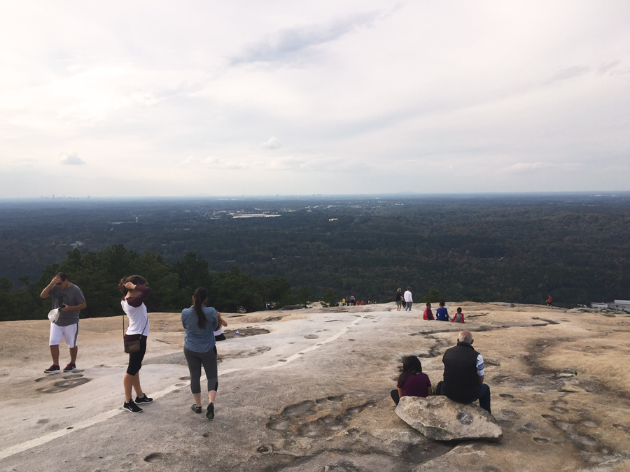 Meredith Lambert Banogon and Lauren Branzei get ready to hike down Stone Mountain after an afternoon on top the granite formation.