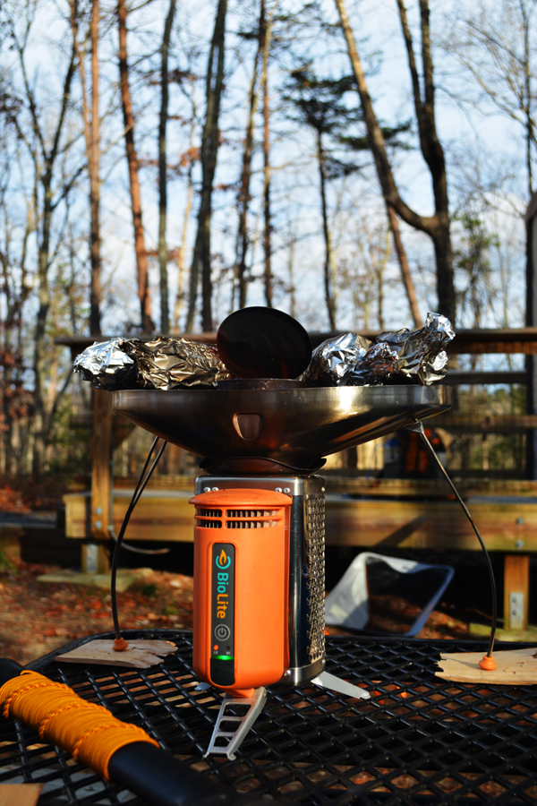 Cooking dinner on a BioLite Stove while camping for a one year wedding anniversary.