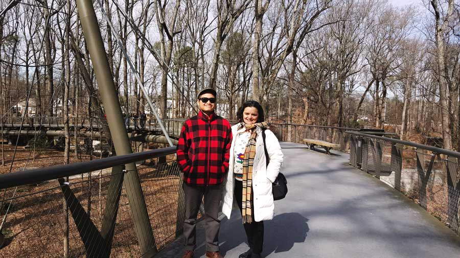 Kevin Banogon and Charlene Kirsten pose in at the Atlanta Botanical Garden within Piedmont Park during the winter.