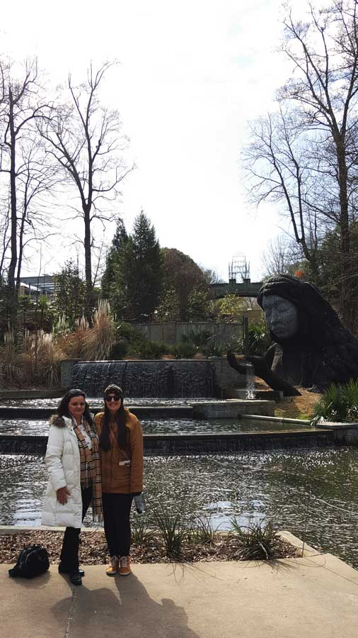 Meredith Lambert Banogon and Charlene Kirsten pose in front of the Lady of the Garden.