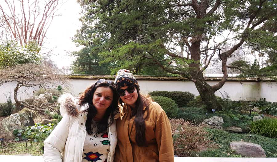 Meredith Lambert Banogon and Charlene Kirsten enjoy the Japanese Garden at the Atlanta Botanical Gardens.