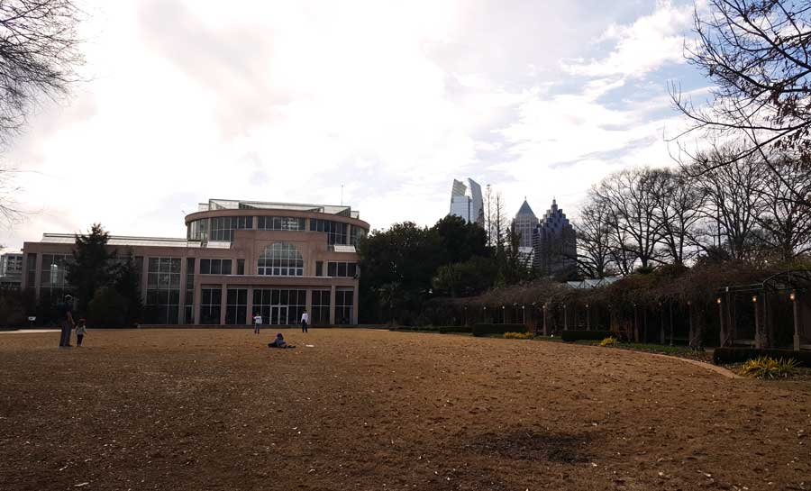 The city of the Atlanta seen from the lawn at the Atlanta Botanical Garden in the winter.