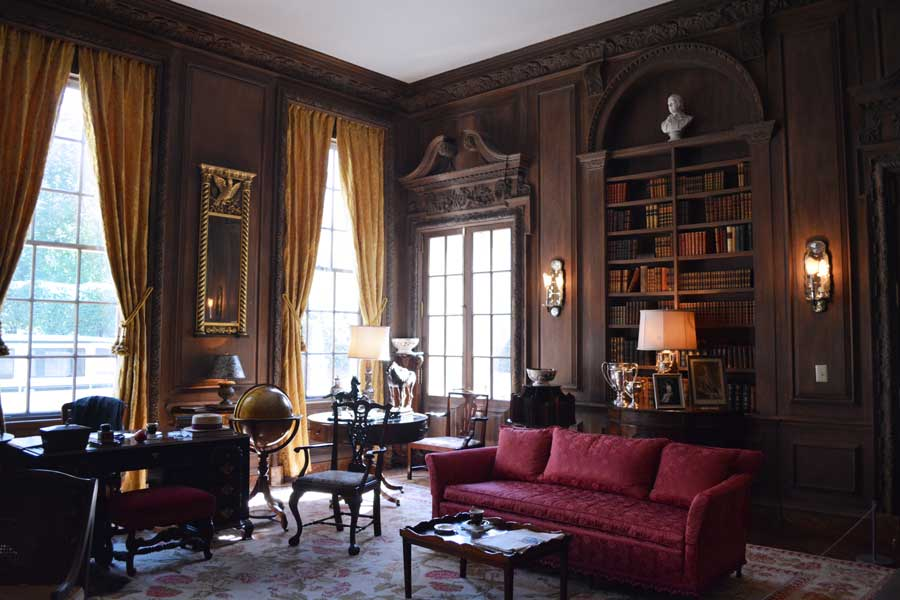 The library and study inside the Swan House in Atlanta, Georgia is filled with dark wood and furniture.