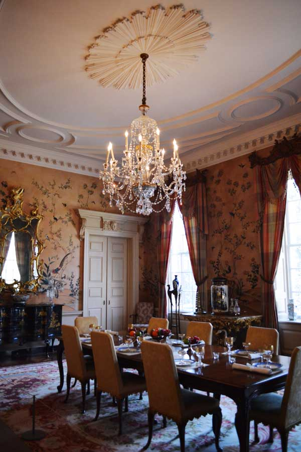 An elegant dining room within the Swan House in Atlanta, Georgia with hand painted wall paper.