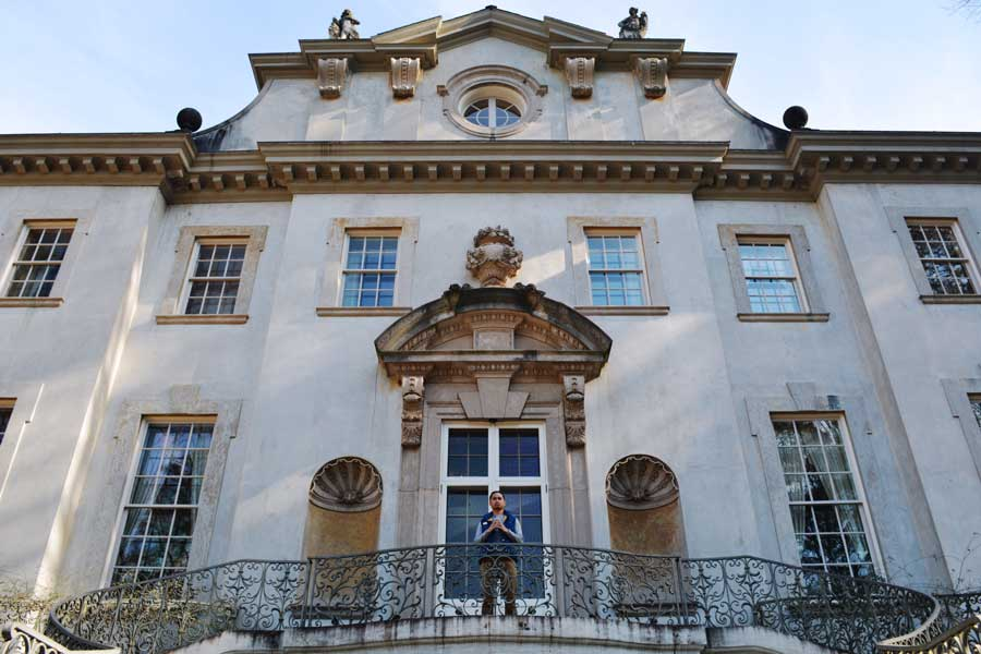 Kevin Banogon stands on the back balcony of The Swan House where President Snow made speeches in The Hunger Games.